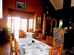 Set near the bar and another indoor fireplace, this indoor dining area at Wakkerstroom Country Inn is popular among both locals and visitors to Wakkerstroom.