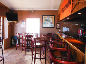 The bar at Wakkerstroom Country Inn, the perfect spot to enjoy an ice cold beer or steaming hot cup of coffee.